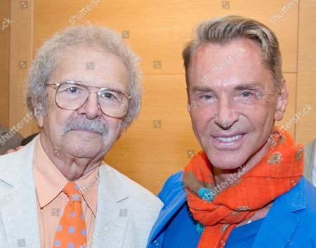 Mel Ramos, Wolfgang Joop German fashion designer and artist Wolfgang Joop, right, smiles beside the U.S. painter Mel Ramos during the opening event of the exhibition 'Beauty and the Beast - Richard Mueller and Mel Ramos at the Museum of the Fine Arts (Museum der bildenden Kuenste) in Leipzig, central Germany, . The exhibition starts on Oct. 13, 2013 and last until Jan. 12, 2014