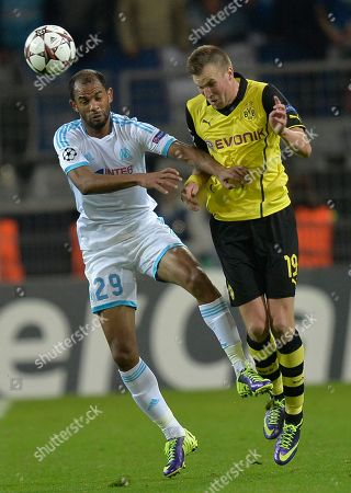 Marseille's Saber Khalifa, left, and Dortmund's Kevin Grosskreutz head for the ball during their Champions League group F soccer match between Borussia Dortmund and Olympique Marseille in Dortmund, Germany