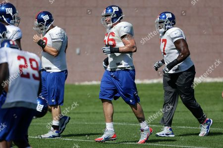 David Diehl, Kevin Boothe New York Giants tackle David Diehl (66) and guard Kevin Boothe warm up during NFL football practice, in East Rutherford, N.J
