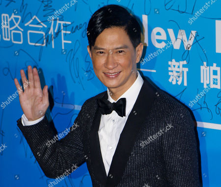 "Nick Cheung In this Oct, 7, 2013 photo, Hong Kong actor Nick Cheung arrives at the 10th Huading Awards ceremony in Macau. The 10th annual Hong Kong Asia Film Festival, which a lineup was unveiled, opens later this month with the world premiere of Benny Chan's ""The White Storm,"" a classic cop thriller reminiscent of the days of John Woo's ""A Better Tomorrow"" and which stars three of Hong Kong's most prolific actors - Sean Lau, Louis Koo and Nick Cheung"