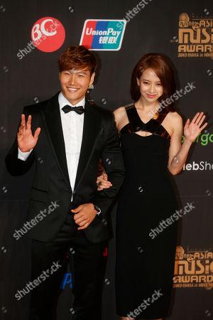 Stock Image of Kim Jong-kook, Song Ji-hyo South Korean singer Kim Jong-kook, left and actress Song Ji-hyo pose for photographers on the red carpet of the Mnet Asian Music Awards (MAMA) in Hong Kong
