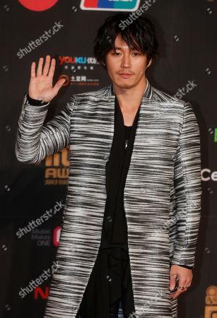 Jang Hyuk South Korean actor Jang Hyuk poses for photographers on the red carpet of the Mnet Asian Music Awards (MAMA) in Hong Kong