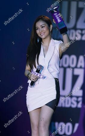 Kay Tse Hong Kong singer Kay Tse holds a trophy after winning the Hong Kong Best Ten Song Award at the Yahoo Buzz Awards