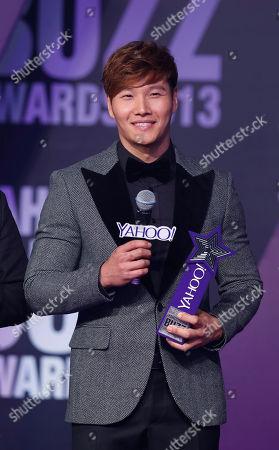 Kim Jong-kook South Korean host Kim Jong-kook holds a trophy after winning the Asia's Most Influential Korean Host at the Yahoo Buzz Awards