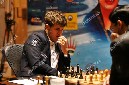 Stock Picture of Viswanathan Anand, Magnus Carlsen Norway's Magnus Carlsen, left, plays against reigning world chess champion India's Viswanathan Anand during the Chess World Championship match in Chennai, India, . The 43- year old Anand has the advantage of playing at home in India, where he is treated as a super star. The 22-year-old Carlsen is the top Western player since Bobby Fischer in a game that has traditionally been dominated by Russians, and chess enthusiasts hope his mass-market appeal can win over new fans and help boost interest worldwide