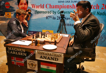 Stock Photo of Viswanathan Anand, Magnus Carlsen Reigning world chess champion India's Viswanathan Anand, right, takes a drink during the Chess World Championship match against Norway's Magnus Carlsen in Chennai, India, . The 43- year old Anand has the advantage of playing at home in India, where he is treated as a superstar. The 22-year-old Carlsen is the top Western player since Bobby Fischer in a game that has traditionally been dominated by Russians, and chess enthusiasts hope his mass-market appeal can win over new fans and help boost interest worldwide