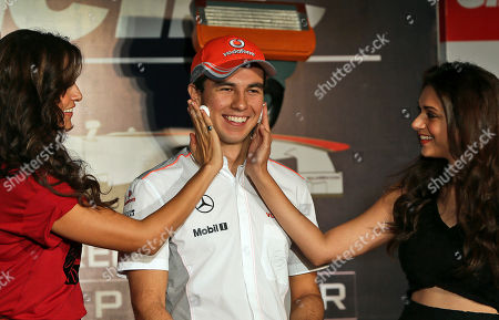 Sergio Perez Bollywood actresses Neha Dhupia, left, and Aditi Rao Hydari rub shaving foam on McLaren Formula One driver Sergio Perez of Mexico during a promotional event in New Delhi, India, . Perez is in the country for the third edition of the Indian Grand Prix which will be held on Oct. 27