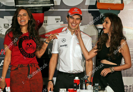 Sergio Perez McLaren Formula One driver Sergio Perez of Mexico is flanked by Bollywood actresses Neha Dhupia, left, and Aditi Rao Hydari during a promotional event in New Delhi, India, . Perez is in the country for the third edition of the Indian Grand Prix which will be held on Oct. 27