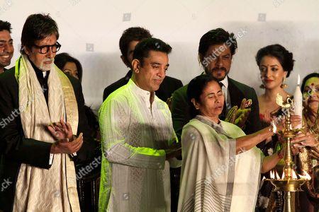 Amitabh Bachchan, Shah Rukh Khan, Kamal Haasan, Mamata Banerjee Chief Minister of India's West Bengal state Mamata Banerjee, front left, lights lamp as Indian superstars Amitabh Bachchan, left, Kamal Haasan, center and Shah Rukh Khan, third right, applaud during the inauguration of the Kolkata film festival in Kolkata, India, Sunday, Nov.10, 2013