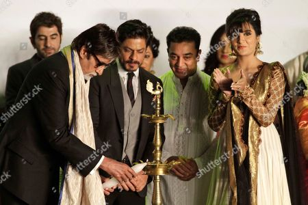 Amitabh Bachchan, Shah Rukh Khan, Kamal Haasan Indian Bollywood superstar Amitabh Bachchan, left, lights the lamp as actors Shah Rukh Khan, center left, and Kamal Haasan, center right, watch during the inauguration of the Kolkata film festival in Kolkata, India, Sunday, Nov.10, 2013