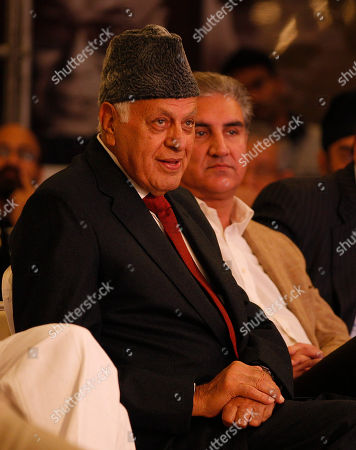 Stock Image of Farooq Abdullah, Shah Mehmood Qureshi Indian Union New and Renewable Energy Minister Farooq Abdullah, left, and Vice Chairman of Pakistan Tehreek-e-Insaf party and former foreign minister of Pakistan Shah Mehmood Qureshi, right, listen to Pakistan's former cricketer and founder of the Tehriq-e-Insaf Imran Khan during the Hindustan Times (HT) Leadership Summit 2013 in New Delhi, India, . World leaders and experts from across the globe attended the two-day summit that began Friday