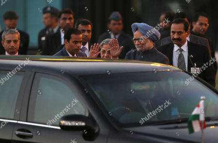 Manmohan Singh, Gursharan Kaur Indian Prime Minister Manmohan Singh and his wife Gursharan Kaur wave as a car carrying Japan's Emperor Akihito and Empress Michiko leave the airport in New Delhi, India, . The Japanese imperial couple are on a week-long visit to India, a country they last visited in 1960