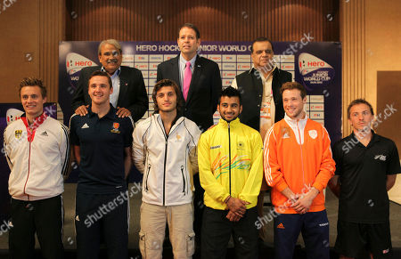 Captains of Junior Men's Field Hockey World Cup participating teams, front row, from left, Germany's Mats Grambush (co-captain), England's Andrew Bull, France's Deront Guillaume, India's Manpreet Singh, the Netherlands' Roel Bovendeert and New Zealand's Robert Creffier pose for photographs, during a press conference ahead of the Junior Men's Field Hockey World Cup conference in New Delhi, India, . Also in the picture are International Hockey Federation (FIH), CEO Kelly Fairweather, second row center and Hockey India Secretary General Narinder Batra, second row right. Sixteen countries are participating in the event scheduled to be held from Dec. 6 - 15 in the Indian capital