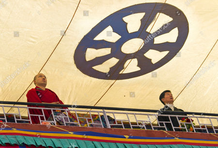 Tibetan Buddhist leader, the 17th Karmapa Ogyen Trinley Dorje, left, watches a program with Prime Minister of the Tibetan government-in-exile Lobsang Sangay at the Tibetan Children's Village School during the school's annual function in Dharmsala, India, . The school, which started as an orphanage in 1960, houses and educates over two thousand refugee Tibetan children