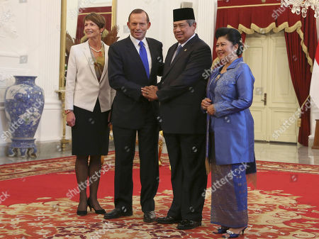 Margie Abbott, Tony Abbott, Susilo Bambang Yudhoyono, Ani Bambang Yudhoyono Australian Prime Minister Tony Abbott, second from left, and his wife Margie, left, pose with Indonesian President Susilo Bambang Yudhoyono, second from right, and his wife Ani for photographers before a meeting at Merdeka Palace in Jakarta, Indonesia, . Abbott arrived Monday for his first trip abroad since taking office, a visit that will likely be dominated by immigration issues as the death toll continues to climb from the latest boat tragedy involving Australia-bound asylum seekers