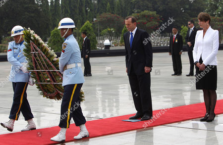 Tony Abott Australian Prime Minister Tony Abbott, center, and his wife Margie Abbott, right, attend a wreath laying ceremony at Kalibata war heroes' cemetery in Jakarta, Indonesia, Monday, Sept. 30. 2013