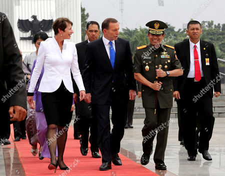 Tony Abbott Australian Prime Minister Tony Abbott, center, and his wife Margie Abbott, left, walk with an Indonesian military official after a wreath laying ceremony at Kalibata war heroes' cemetery in Jakarta, Indonesia, Monday, Sept. 30. 2013