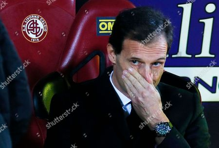 AC Milan coach Massimiliano Allegri waits for the start of a Serie A soccer match between Livorno and AC Milan in Leghorn, Italy. AC Milan announced on its website that it fired Allegri and put assistant Mauro Tassotti temporarily in charge following AS Milan's embarassing 4-3 loss to Sassuolo on Sunday, Jan. 12