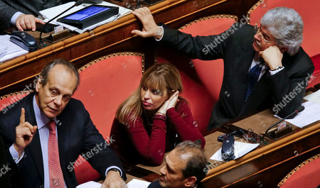Francesco Nitto Palma, Alessandra Mussolini, Antonio Razzi From left, Senators Francesco Nitto Palma, Alessandra Mussolini and Antonio Razzi wait for the start of a vote in the Italian Senate in Rome on wether to kick Italian Former Premier Silvio Berlusconi out of the Parliament because of his tax fraud conviction, . Berlusconi was convicted last year over the purchase of rights to broadcast U.S. movies on his Mediaset empire through a series of offshore companies that involved the false declaration of payments to avoid taxes. Italy's high court upheld the conviction and four-year prison sentence on Aug. 1. The Senate vote is based on a 2012 law that bans anyone sentenced to more than two years in prison from holding or running for public office for six years