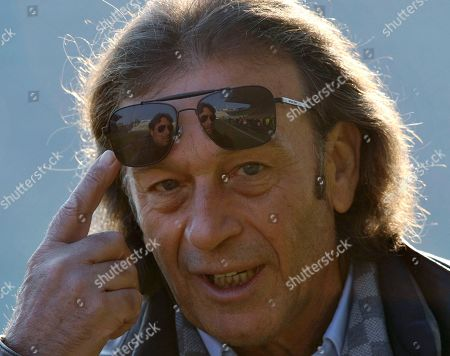Stock Image of Massimo Cellino FILE - A photo from files of the then Cagliari president Massimo Cellino gesturing prior to the Serie A soccer match between Parma and Cagliari at Parma's Tardini stadium. Massimo Cellino _ with his sunglasses and slick, graying hair _ breezed into Elland Road in April when his company, which already owned Italian side Cagliari, bought a controlling stake in Leeds. This was the biggest football team in England in the late 1960s and early '70s in the era of Johnny Giles and Billy Bremner, the league champion in 1992 when Eric Cantona starred up front and a Champions League semifinalist only 12 years ago