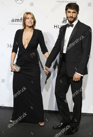 Barbara Berlusconi, left, arrives with her boyfriend Lorenzo Guerrieri for the amfAR charity dinner during the fashion week in Milan, Italy