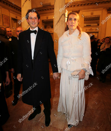 "Fiat President John Elkann, left, arrives with his wife Lavinia Borromeo at the Milan La Scala theater, Italy, for the season's opera opening. Milan opera house La Scala is concluding its bicentennial celebrations of Giuseppe Verdi's birth with Daniele Gatti conducting ""La Traviata"" at the gala season opener Saturday. Although ""La Traviata"" is Verdi's most popular opera, it hasn't been performed at La Scala, which was long Verdi's musical home, in more than a decade"