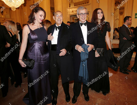 """Stock Picture of Franco Tato', second from left, his wife Sonia Raule, and Chicco Testa, second from right, arrive at the Milan La Scala theater, Italy, for the season's opera opening. Milan opera house La Scala is concluding its bicentennial celebrations of Giuseppe Verdi's birth with Daniele Gatti conducting """"La Traviata"""" at the gala season opener Saturday. Although """"La Traviata"""" is Verdi's most popular opera, it hasn't been performed at La Scala, which was long Verdi's musical home, in more than a decade"""