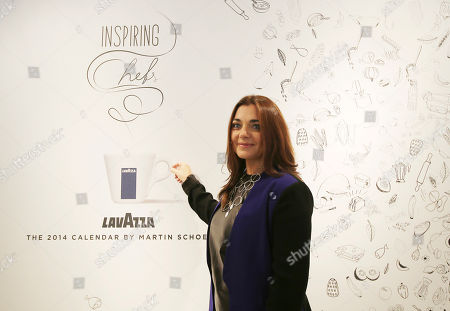 """Francesca Lavazza poses prior to the start of a press conference for the official presentation of """"2014 Lavazza calendar"""", in Milan, Italy, . AP Photo/Antonio Calanni"""