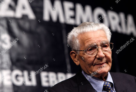 "Enzo Camerino Holocaust survivor Enzo Camerino, 84, speaks on a stage during a demonstration following a march marking the 70th anniversary of the roundup and deportation of Rome's Jews to concentration camps, in Rome's ghetto neighborhood, . Nazi forces rounded up more than 1,000 Jews from Rome's ghetto and nearby neighborhoods and sent them by train to Auschwitz. Camerino is one of the two still alive out of the only 16 who survived. He was 14 when he, his mother, father, brother, sister and uncle were taken from their home at Viale delle Milizie near the Vatican. In an interview with The Associated Press he described how the family was kept at Rome's military college for two days, then taken by train and brought to Auschwitz in a railway car chock full of women, children and the sick. Rome's Jewish community gathered Wednesday amid deep anger over the late Nazi war criminal Erich Priebke and his Holocaust-denying final statement. Priebke died Friday in Rome, where he was serving a life term for his role in the 1944 massacre of 335 civilians at the Ardeatine Caves outside the capital. Asked how the recent furor over Priebke has affected him, Camerino said he felt little emotion but acknowledged the unfairness of life. ""For me, he never should have lived to be 100,"" he told the AP"