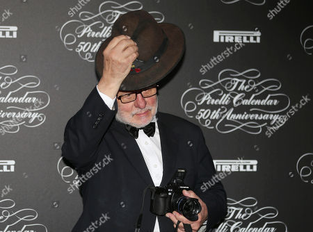 Stock Picture of Britain photographer Barry Lategan poses at the 2014 Pirelli Calendar red carpet event in Milan, Italy, . The calendar debuted in 1964 as a racy way of promoting Italian tire maker Pirelli and has since grown into a fashion institution