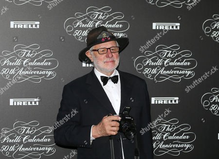 Britain photographer Barry Lategan poses at the 2014 Pirelli Calendar red carpet event in Milan, Italy, . The calendar debuted in 1964 as a racy way of promoting Italian tire maker Pirelli and has since grown into a fashion institution