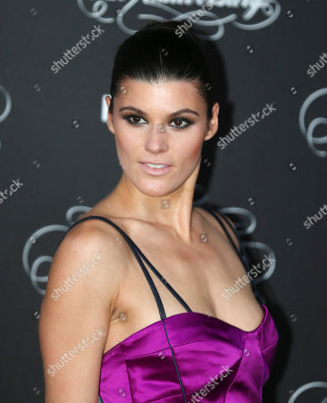 Stock Image of American model Summer Rayne Oakes poses at the 2014 Pirelli Calendar red carpet event in Milan, Italy, . The calendar debuted in 1964 as a racy way of promoting Italian tire maker Pirelli and has since grown into a fashion institution