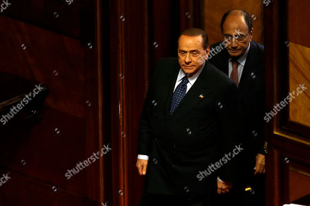 Stock Picture of People of Freedom party leader Silvio Berlusconi is followed by senator Renato Schifani as he arrives to deliver his speech at the Senate, in Rome, . Italian premier Enrico Letta was putting his government's survival to confidence votes in Parliament on Wednesday amid a divisive split in Silvio Berlusconi's party that could at least temporarily save his fragile ruling coalition