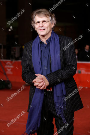 Daniel Pennac Writer Daniel Pennac poses for photographers as he arrives for the screening of the movie 'Au bonheur des ogres', at the 8th edition of the Rome International Film Festival, in Rome