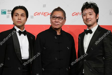 Stock Image of From left, actor Satoshi Judai, director Takashi Miike and actor Hiroaki Harada pose for photographers during the photo call of the movie Blue Planet Brothers at the 8th edition of the Rome International Film Festival in Rome