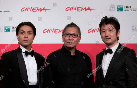 Stock Picture of From left, actor Satoshi Judai, Director Takashi Miike and actor Hiraoki Harada pose for photographers during the photo call of the movie Blue Planet Brothers at the 8th edition of the Rome International Film Festival in Rome
