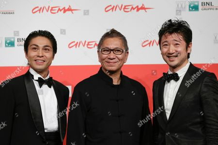 Stock Photo of From left, actor Satoshi Judai, director Takashi Miike and actor Hiroaki Harada pose for photographers during the photo call of the movie Blue Planet Brothers at the 8th edition of the Rome International Film Festival in Rome