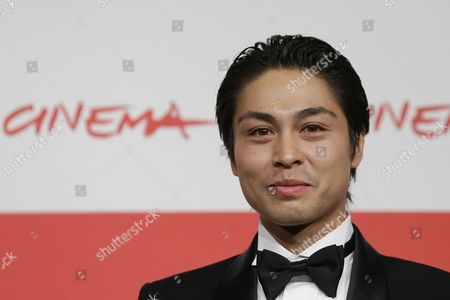 Actor Satoshi Judai poses for photographers during the photo call of the movie 'Blue Planet Brothers' at the 8th edition of the Rome International Film Festival in Rome