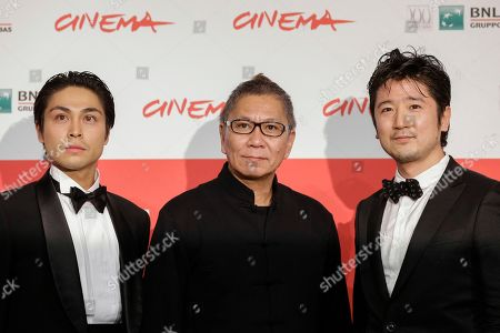 From left, actor Satoshi Judai, director Takashi Miike and actor Hiroaki Harada pose for photographers during the photo call of the movie Blue Planet Brothers at the 8th edition of the Rome International Film Festival in Rome