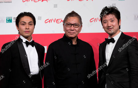 From left, actor Satoshi Judai, Director Takashi Miike and actor Hiraoki Harada pose for photographers during the photo call of the movie Blue Planet Brothers at the 8th edition of the Rome International Film Festival in Rome