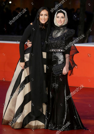 Dana Keilani, Sara El Debuch Actresses Dana Keilani, left, and Sara El Debuch pose for photographers during the red carpet for the movie 'Border', at the 8th edition of the Rome International Film Festival, in Rome, . (AP Photo