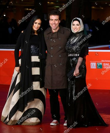 From left, actress Dana Keilani, director Alessio Cremonini and actress Sara El Debuch pose for photographers during the red carpet for the movie 'Border', at the 8th edition of the Rome International Film Festival, in Rome, . (AP Photo