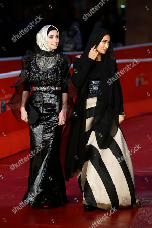 Actresses Dana Keilani, left, and Sara El Debuch pose for photographers during the red carpet for the movie 'Border', at the 8th edition of the Rome International Film Festival, in Rome, . (AP Photo