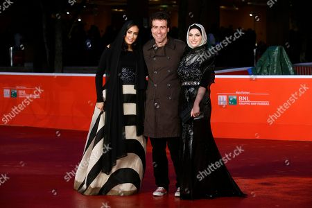 Stock Photo of From left, actress Dana Keilani, director Alessio Cremonini and actress Sara El Debuch pose for photographers during the red carpet for the movie 'Border', at the 8th edition of the Rome International Film Festival, in Rome, . (AP Photo