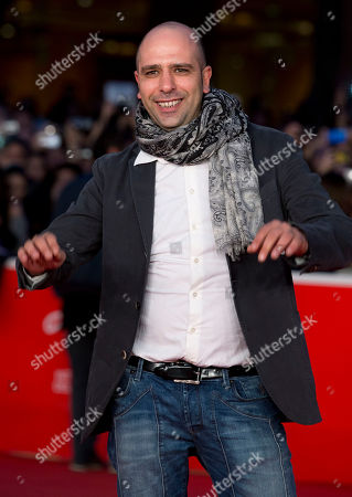Checco Zalone Actor Checco Zalone poses for photographers as he arrives for an event at the 8th edition of the Rome International Film Festival, in Rome