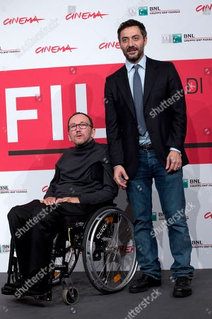 Director Mirko Locatelli, left, and actor Filippo Timi pose for photographers during the photo call for the movie 'I corpi estranei', at the 8th edition of the Rome International Film Festival, in Rome