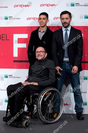 Director Mirko Locatelli, in wheelchair, actors Jaouher Brahim, left, and Filippo Timi pose for photographers during the photo call for the movie 'I corpi estranei', at the 8th edition of the Rome International Film Festival, in Rome