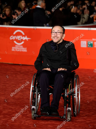 Director Mirko Locatelli poses for photographers during the red carpet of the movie 'I Corpi Estranei', at the 8th edition of the Rome International Film Festival, in Rome, . (AP Photo