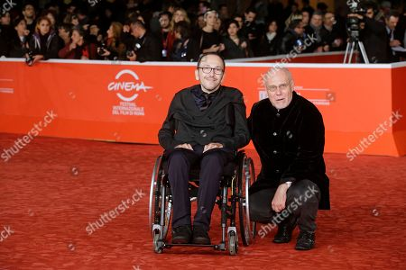 Director Mirko Locatelli, left, and Rome Film Festival artistic director Marco Muller pose for photographers during the red carpet for the movie 'I Corpi Estranei', at the 8th edition of the Rome International Film Festival, in Rome