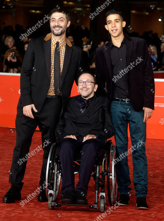 Actors Filippo Timi, left, Jaouher Brahim, right, and director Mirko Locatelli pose for photographers during the red carpet of the movie 'I Corpi Estranei', at the 8th edition of the Rome International Film Festival, in Rome, . (AP Photo